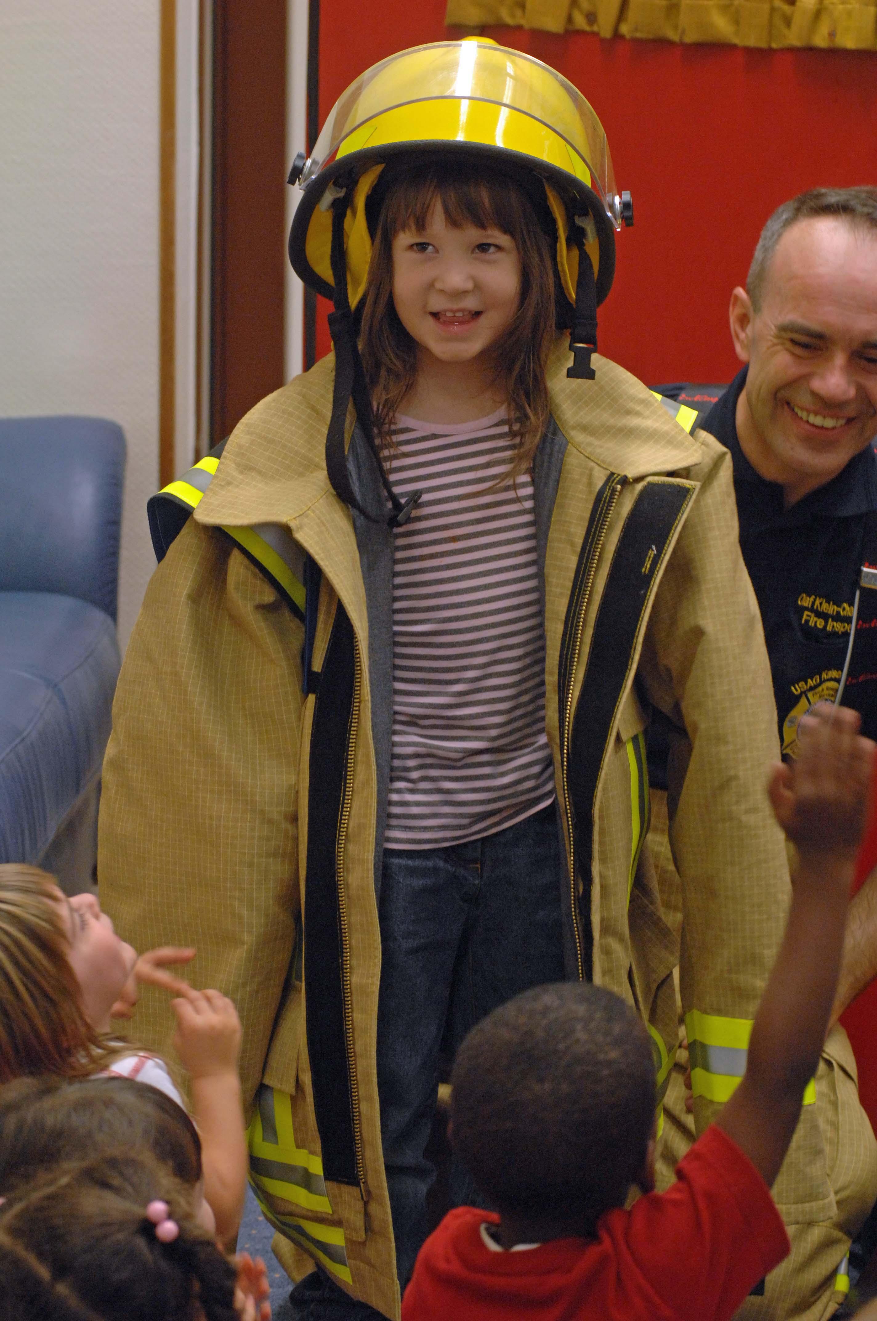 Girl dressed like firefighter