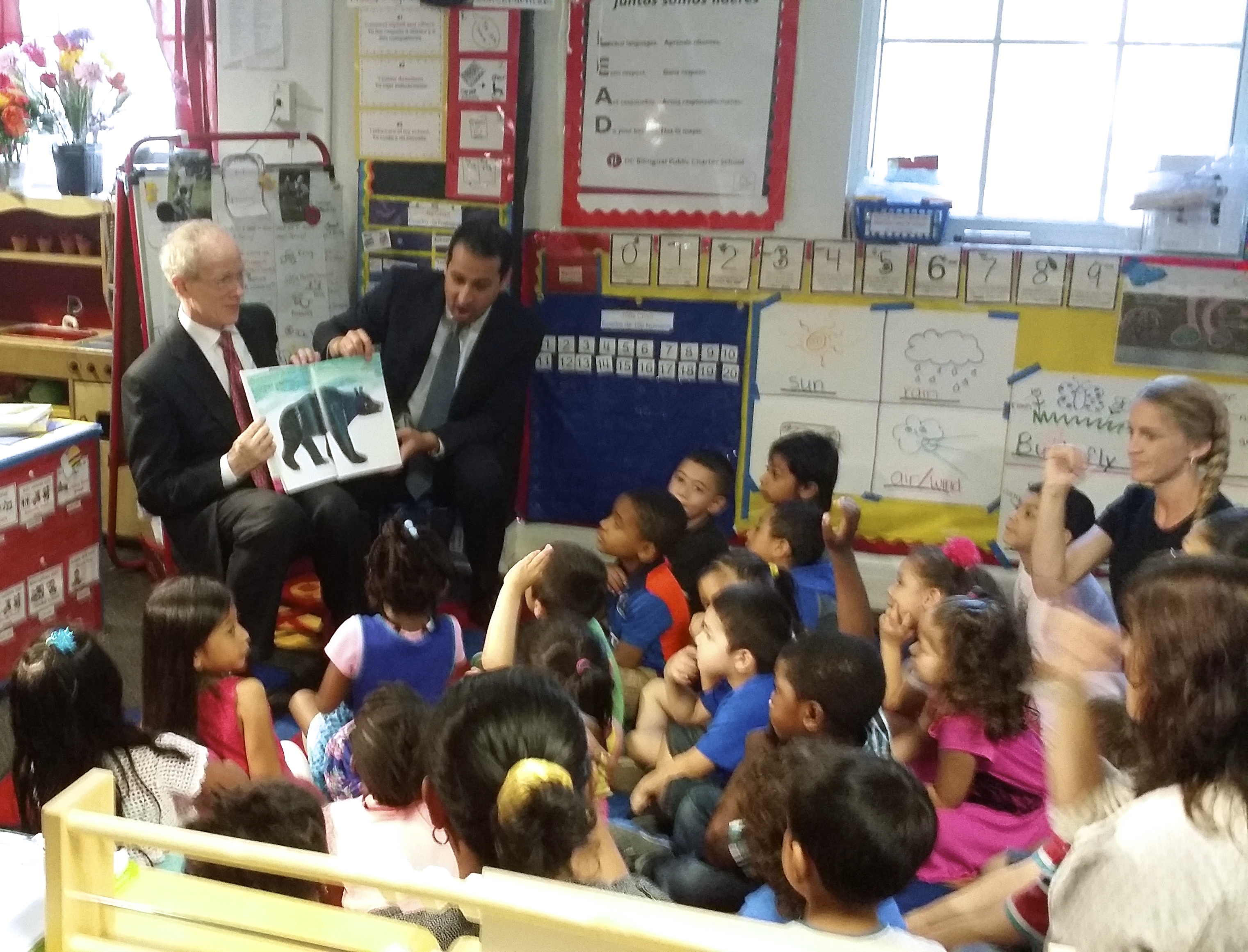 NIEER Director Steve Barnett & Roberto Rodriguez of the White House Domestic Policy Council read to children at CentroNía/DC Bilingual Public Charter School .